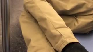 Guy puts his smelly feet out on subway seat