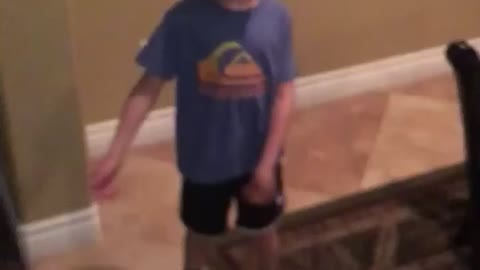 Kid flossing and ending with a dab