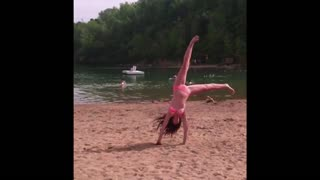 Girl fails cartwheel and face plants into sand