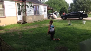 Little boy blue tank top back flip tree fail - Video