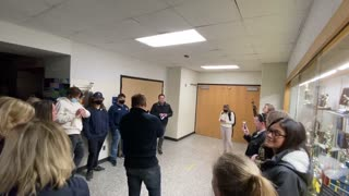 Hudsonville Parents Locked out of Board Meeting listen in Hallway