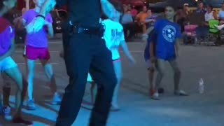 Officer Boogies with Kids at Street Party