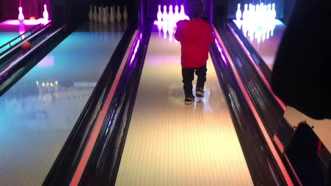 Clever baby finds the best way to get a bowling strike