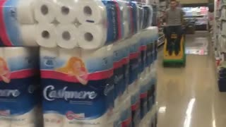 Shopping cart into toilet paper