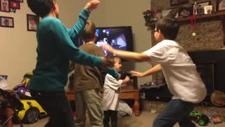 Trio Of Boys Try To Follow Dance Routine On TV