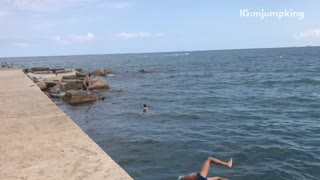 Guy blue speedo side flip into water fail