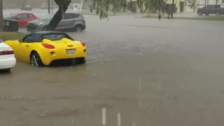 Cars Sit in Water as Rain Storms Flood Corpus Christi Parking Lot - Video