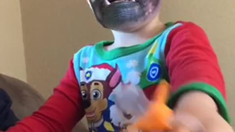 Adorable 2 year old tries to be scary.