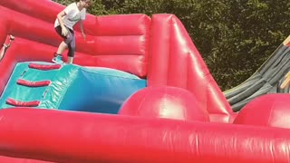 This Ninja Warrior Loves To Play In An Inflatable Park