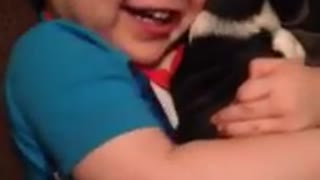 Toddler shows how much he loves his new puppy