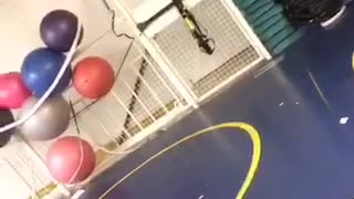 Girl in yellow shirt tries to do front flip on pull ropes and falls forward - Video