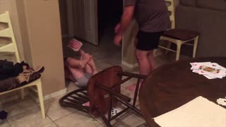 Little Boy Falls Off Chair And Pees His Pants While Playing Game With Dad - Video