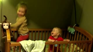 Sibling Giggles - Baby Laughs at Sister Jumping in Crib - Video