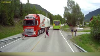 Semi Truck Narrowly Misses Kids Crossing Street - Video