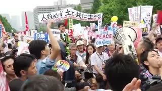 Tokyo protest rails against PM Abe's security bills - Video
