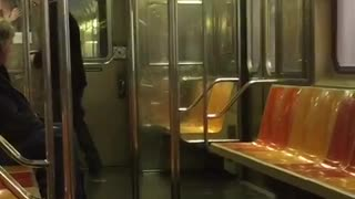 Old man black jacket dancing in empty subway car