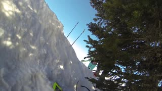Gopro guy on green skiis crashes while going downhill  - Video