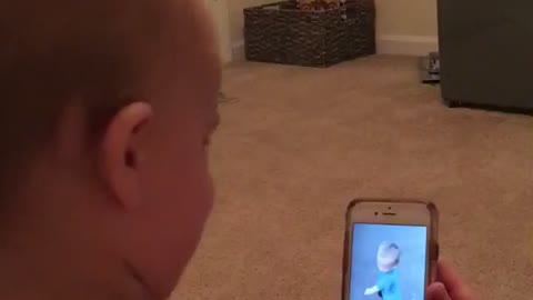 Baby laughing at video of himself