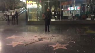 Pickax-Wielding Vandal Smashes President Trump's Hollywood Walk of Fame Star - Video