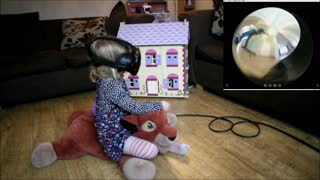 VR allows little girl to ride through house on cat - Video