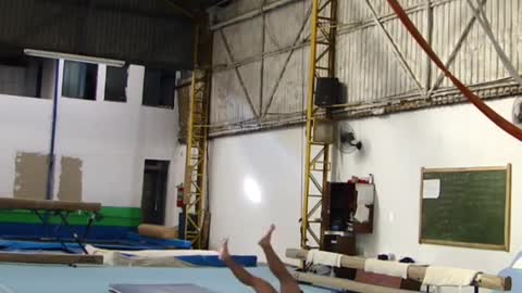 Shirtless guy gymnastics hanging rings balance fail