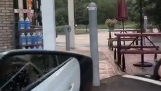 Guy jumps over pole gets shorts stuck falls - Video