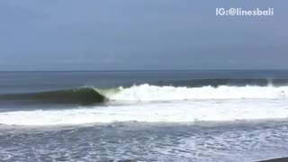 Guy surfs then surf in reverse