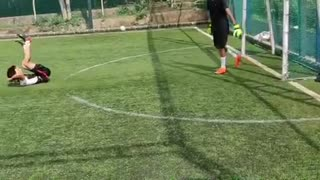 Slow motion kid misses kicking green soccer ball - Video