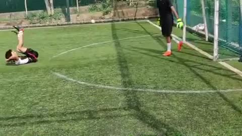 Slow motion kid misses kicking green soccer ball