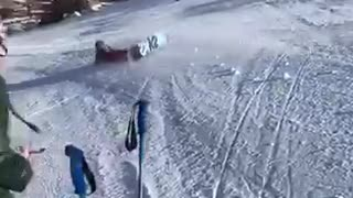 Snowboarder black helmet tries to 360 spin lands on head - Video