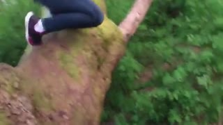 Girl grey sweater rope swing slip fail dirt