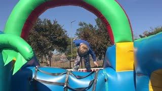 Slo-mo front flip fail-jumping castle - Video