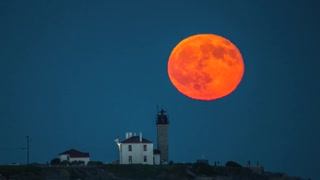 Incredible Full Moon Rising Timelapse Over Lighthouse - Video