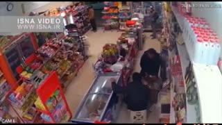Supermarket robbery caught on CCTV - Video