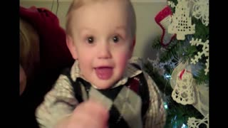 Little boy rocks deck the halls in his best cristmas attire