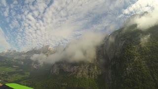 Wingsuit proximity flying through the clouds