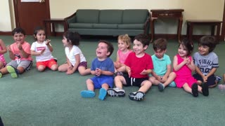 Little Boy Can't Stop Laughing Contagiously During Music Class - Video