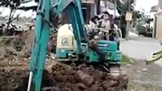 5 & 6  year old boy driving digger/excavator on his own - Video