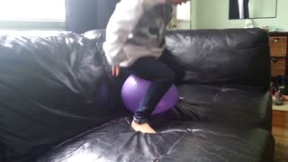 Toddler tries to pop a balloon to no prevail