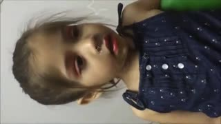 Toddler falls asleep during makeup session - Video