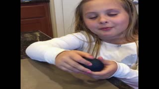 Girl fails to make a rubber egg - Video