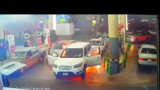 The terrifying moment a car catches fire at a petrol station - Video