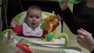 Baby's mind blown while watching mom drink