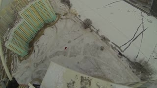 BASE jumper crashes into building in Russia - Video