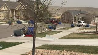 Strong Wind Sends Trash Flying - Video
