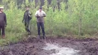 Fool jumps in mud - Video