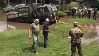 People Come Together to Help Military Truck - Video