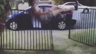 Party time guy tries to jump over black fence falls over - Video