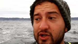 Man on boat in sea fish thrown in his face