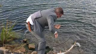 Man Catches Fish Moments Before Wedding